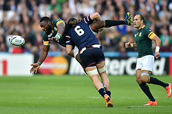 Tendai Mtawarira of South Africa offloads the ball after being tackled by Daniel Barrett of the USA - Mandatory byline: Patrick Khachfe/JMP - 07966 386802 - 07/10/2015 - RUGBY UNION - The Stadium, Queen Elizabeth Olympic Park - London, England - South Africa v USA - Rugby World Cup 2015 Pool B.