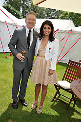 SIR KENNETH BRANAGH and KATIE MELUA at the Cartier Queen's Cup Polo Final, Guards Polo Club, Windsor Great Park, Berkshire, on 17th June 2012.