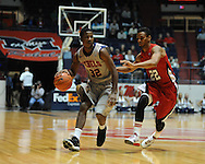 """Ole Miss' Jarvis Summers (32) drives against Louisiana-Lafayette's Raymone Andrews (22) at C.M. """"Tad"""" Smith Coliseum in Oxford, Miss. on Wednesday, December 14, 2011. (AP Photo/Oxford Eagle, Bruce Newman)"""