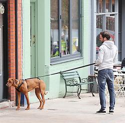 Manchester United's Juan Mata and his girlfriend Evelina Kamph take their 10 month old Rhodesian Ridgeback to breakfast