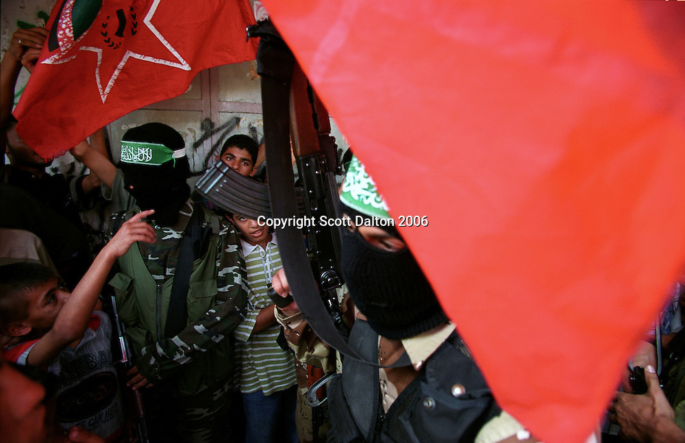 Masked members of HAMAS, the Islamic Resistance Movement, march with the funeral procession of a fellow HAMAS member who was killed by Israeli troops in Khan Yunus in the Gaza Strip. (Photo/Scott Dalton)