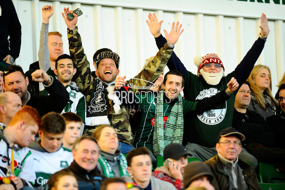 Plymouth fans in the Devenport Stand with their arms in the air before the EFL Sky Bet League 2 match between Plymouth Argyle and Wycombe Wanderers at Home Park, Plymouth, England on 26 December 2016. Photo by Graham Hunt.