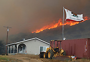 June 20, 2016 - Duarte, California, U.S. - The California state flag flies next to a home on Highway 94 south Potrero on Monday as flames roar behind it. <br /> ©Exclusivepix Media