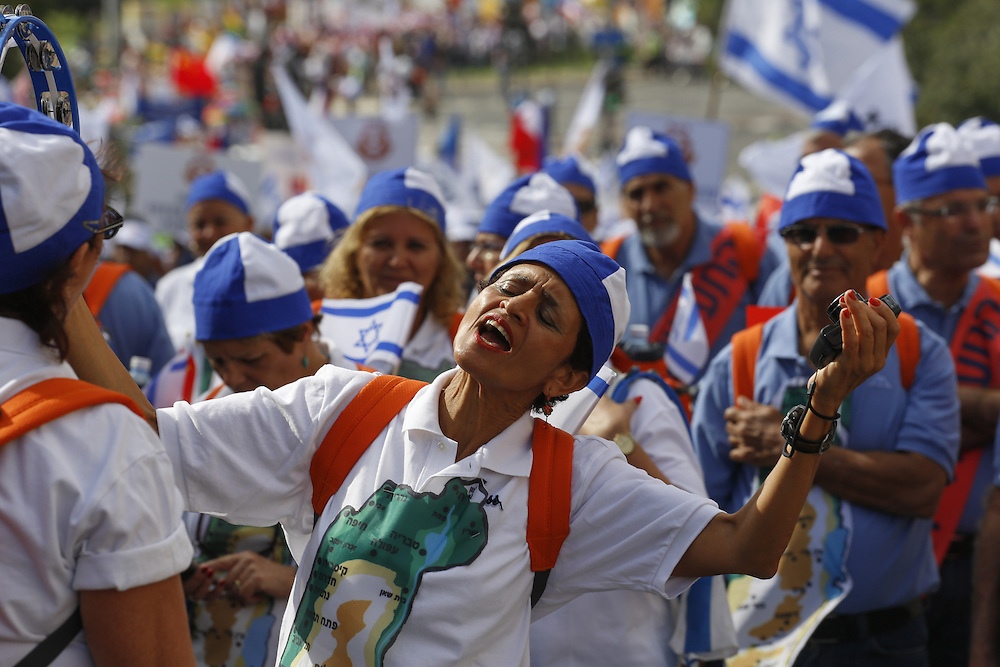 An Israeli woman  wears an Israeli cap and sings during Jerusalem`s annual parade. Thousands of Christian Evangelists and Israelis attend a parade in the center of Jerusalem, marking the Jewish holiday of Sukkot or the Feast of the Tabernacles. Sep 24, 2013.  Photo by Oren Nahshon