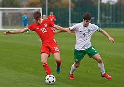 WREXHAM, WALES - Wednesday, October 30, 2019: Wales' Cameron Congreve (L) and Republic of Ireland's captain Darragh Reilly during the 2019 Victory Shield match between Wales and Republic of Ireland at Colliers Park. (Pic by David Rawcliffe/Propaganda)