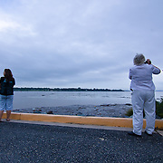 Residents of Seneca Pointe watch and photograph the rising Susquehanna river Thursday, Sept. 08, 2011 in Havre De Grace, MD.<br /> <br /> Flooding from the remnants of Tropical Storm Lee drove hundreds of Maryland residents from their homes Thursday and claimed at least one life less than two weeks after Hurricane Irene soaked the national capital region. (AP Photo, Saquan Stimpson)