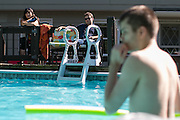 Michelle Fidler-Sutherland and Joshua Fidler, 20, watch as Jacob, 17, swims at a friend's house in Hamlin on Tuesday, July 28, 2015.