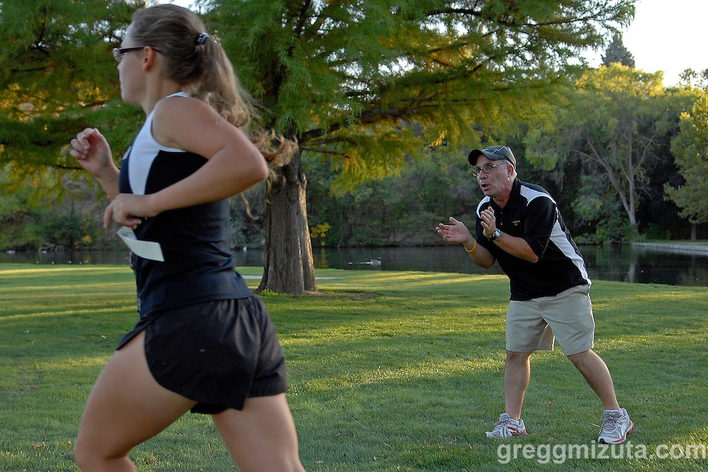 Capital head coach John Doherty encourages a runner during the Boise City Meet at Ann Morrison Park on October 14, 2010.