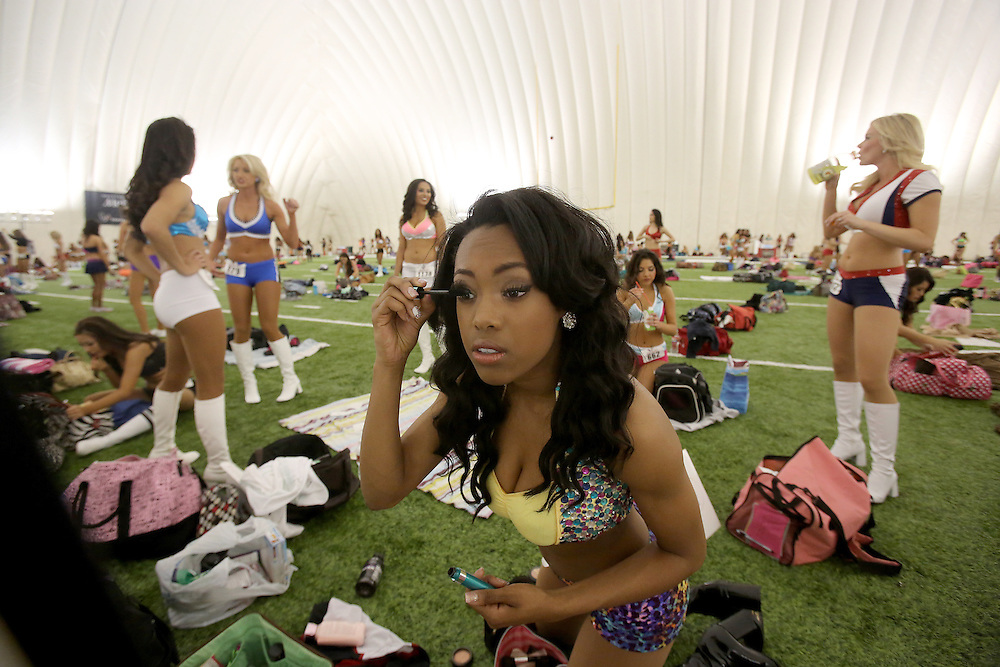 4/5/14: Morgan Jones, from Pearland applies makeup before her dance routine. This is Morgan's first year trying out for the team. Ladies wearing a variety of outfits and ranging from 18 years of age into thither 30's tried out for the 2014-15 Houston Texas Cheerleading Team at the practice bubble on the Houston Texans grounds in Houston, Texas. Music was provided by DJ Ran.