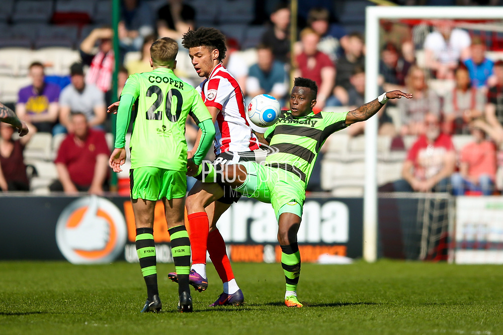 Interception from Forest Green Rovers midfielder Drissa Traore (4)  during the Vanarama National League match between Lincoln City and Forest Green Rovers at Sincil Bank, Lincoln, United Kingdom on 25 March 2017. Photo by Simon Davies.