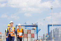 Workers walking in shipping yard