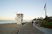 Woman Walking Her Dog on the Boardwalk at Main Beach Park in Downtown Laguna Beach