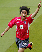 South Korea's Ahn Jung-Hwan celebrates his first goal in the second half of a Group D match at the World Cup Finals in Daegu, June 10, 2002. Photo by Lee Jae-Won (SOUTH KOREA) www.leejaewonpix.com