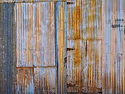 Detail of the wall of an old tin shack in the Arizona desert with a wonderful assortment of shiny and scratched colors and textures.