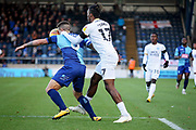 Peterborough United forward Ivan Toney (17) gets physical during the EFL Sky Bet League 1 match between Wycombe Wanderers and Peterborough United at Adams Park, High Wycombe, England on 3 November 2018.