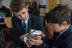 Camden City Learning Centre, London, June 15th 2015. London Mayor Boris Johnson joins future entrepreneurs at Camden City Learning Centre to launch London Technology Week and to launch a dedicated online hub for the Capital's thriving technology industry. PICTURED: Students examine one of the Lego robots that they are programming.