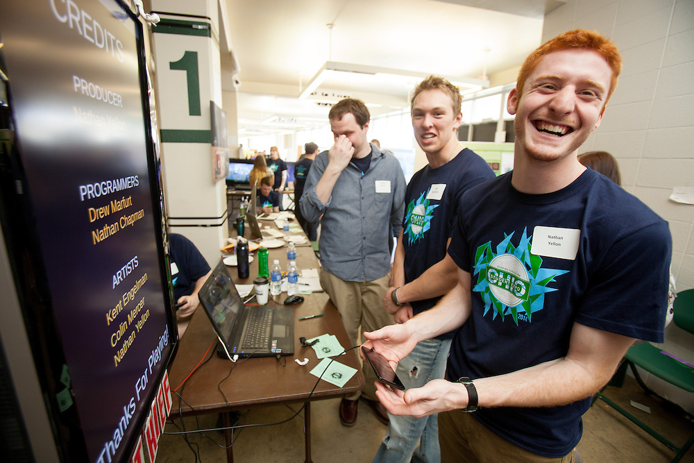Nathan Yellon, a Games and Animation major, demonstrates the mobile based game he helped design at the annual Student Research and Creative Activity Expo at Ohio University.  More than 800 participants from 56 departments and schools took part in the event. Photo by Ohio University / Jonathan Adams