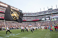 Army cheerleaders run onto the field ahead of the team during the Army Navy football game at Lincoln Financial Field in Philadelphia, PA on December 12, 2015. (Alan Lessig/Staff)