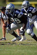 Defensive end Darrell Lee and the Dallas Cowboys work out at their summer training camp in Oxnard, CA on 08/03/2004. ©Paul Anthony Spinelli