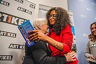 DEN HAAG - Ian van der Kooye  en Juanita Hernandez  en Anne-Ruth Wertheim Lijsttrekker Sylvana Simons presenteert haar boek Artikel 1 in Nieuwspoort. Simons overhandigt het boek aan de jongste kandidaat en de oudste kandidaat op de lijst van Artikel 1. COPYRIGHT ROBIN UTRECHT