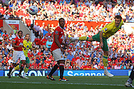 Picture by Paul Chesterton/Focus Images Ltd.  07904 640267.1/10/11.Anthony Pilkington of Norwich heads for goal during the Barclays Premier League match at Old Trafford Stadium, Manchester.