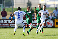 18.07.2014, Sportplatz Jettingen, Jettingen, GER, FS Vorbereitung, Karlsruher SC vs FC Augsburg, im Bild l-r: im Zweikampf, Aktion, mit Reinhold Yabo #8 (Karlsruher SC) und Dominik Kohr #21 (FC Augsburg) // during a Friendly Match between Karlsruher SC and FC Augsburg at the Sportplatz Jettingen in Jettingen, Germany on 2014/07/18. EXPA Pictures © 2014, PhotoCredit: EXPA/ Eibner-Pressefoto/ Kolbert<br /> <br /> *****ATTENTION - OUT of GER*****