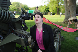 Pictured: Ruth get's some pointers before firing the gun to start the event.<br /> <br /> Scottish Conservatives leader Ruth Davidson get's the ball rolling on the soldiers charity golf event by firing the 105th Regiment's gun at Duddingston Golf Course.<br /> <br /> © Dave Johnston/ EEm