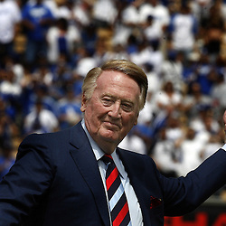 Vin Scully tossed out the first pitch in honor before the home opener between the San Francisco Giants and the Los Angeles Dodgers at Dodger Stadium on Monday April 13, 2009 in Los Angeles. (SGVN/Staff Photo by Keith Birmingham/SPORTS)