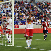 New York Red Bulls player Roy Miller holds his head in his hands after missing an easy chance during the New York Red Bulls V Chivas USA Major League Soccer match at Red Bull Arena, Harrison, New Jersey, 23rd May 2012. Photo Tim Clayton