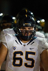 Nov 19, 2011; Stanford CA, USA;  California Golden Bears offensive linesman Dominic Galas (65) enters the field before the game against the Stanford Cardinal at Stanford Stadium.  Stanford defeated California 31-28. Mandatory Credit: Jason O. Watson-US PRESSWIRE