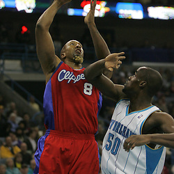 Jan 13, 2010; New Orleans, LA, USA; Los Angeles Clippers center Brian Skinner (8) shoots over New Orleans Hornets center Emeka Okafor (50) during the first quarter at the New Orleans Arena. Mandatory Credit: Derick E. Hingle-US PRESSWIRE
