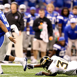 Dec 20, 2009; New Orleans, LA, USA; Middle Tennessee State Blue Raiders quarterback Dwight Dasher (9) breaks away from a tackle by Southern Miss Golden Eagles defensive back Chico Hunter (30) during the second half of the 2009 New Orleans Bowl at the Louisiana Superdome. Middle Tennessee State defeated Southern Miss 42-32. Mandatory Credit: Derick E. Hingle-US PRESSWIRE