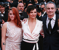 Kristen Stewart, Juliette Binoche, director Olivier Assayas at Sils Maria gala screening red carpet at the 67th Cannes Film Festival France. Friday 23rd May 2014 in Cannes Film Festival, France.