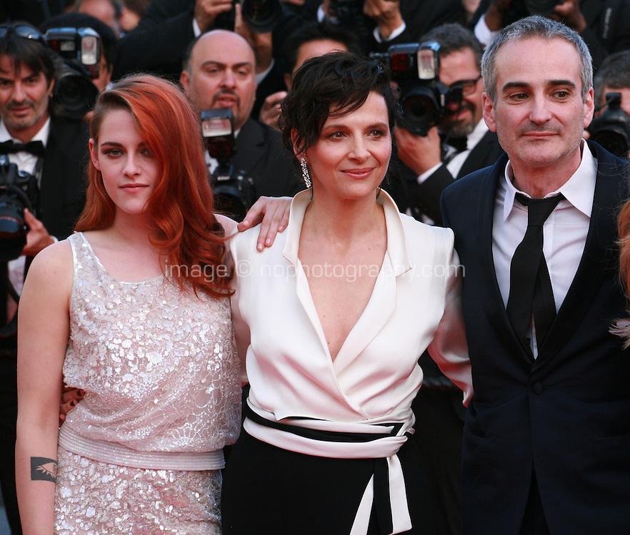 Kristen Stewart, Juliette Binoche, director Olivier Assayas at Sils Maria gala screening red carpet at the 67th Cannes Film Festival France. Friday 23rd May 2014 in Cannes Film Festival, France.
