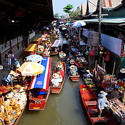 The Dumnoen Saduak Floating Market, a peculiar market place located at Dumnoen Saduak District in the Ratchaburi Province, about 105 kms from Bangkok.