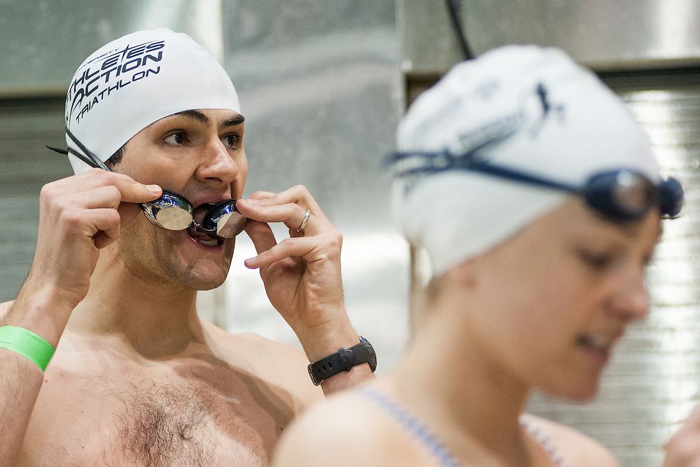 Curt Sykes (left) breathes on his goggles before the start fo the Race for a Reason Triathlon. Photo by: Ross Brinkerhoff. Race for a Reason, Race 4 A Reason, Annual Events, Events, Students, Faculty & Staff