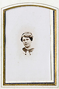 small fading 1900s portrait of adult woman in golden passe-partout frame