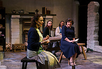 The Mundy sisters together in their kitchen during dress rehearsal for Dancing at Lughnasa with the Winnipesaukee Playhouse on Tuesday.  (l-r) Tamara McGonagle (Maggie Mundy), Delaney Andrews (Christina Mundy), Margaret Lundberg (Agnes Mundy), Nerrishia Bodwell (Rose Mundy - lying on floor) and Doreen Fotino Sheppard (Kate Mundy).    (Karen Bobotas/for the Laconia Daily Sun)