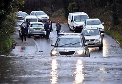 © London News Pictures. 21/11/16. Leckwith, UK. Drivers risking cars by driving though flood water blocking a road  in Leckwith in the Vale of Glamorgan, Wales, as heavy rain and strong winds hit the South West of the UK following Storm Angus. Photo credit: Ian Homer/LNP