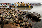 "A barge carrying food and supplies from the last cargo ship of the season is offloaded onto the rocky beach at low tide in Iqaluit, Nunavut, Canada. (From the book What I Eat, Around the World in 80 Diets.) Pack ice typically closes regional shipping lanes from October until early July. ""Iqaluit"" means 'place of many fish'."