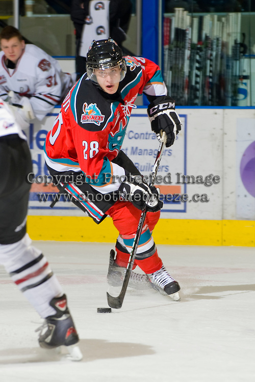 KELOWNA, CANADA, NOVEMBER 9: Austin Ferguson #28 of the Kelowna Rockets skates with the puck as the Red Deer Rebels visit the Kelowna Rockets  on November 9, 2011 at Prospera Place in Kelowna, British Columbia, Canada (Photo by Marissa Baecker/Shoot the Breeze) *** Local Caption ***