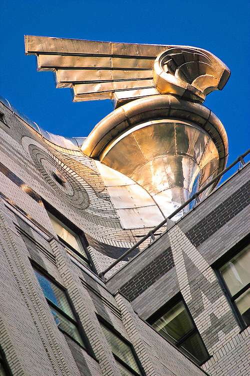 A giant, soaring, stainless steel, Art Deco detail on the Chrysler Building, was inspired by the hood ornaments on 1929 Chrysler cars.