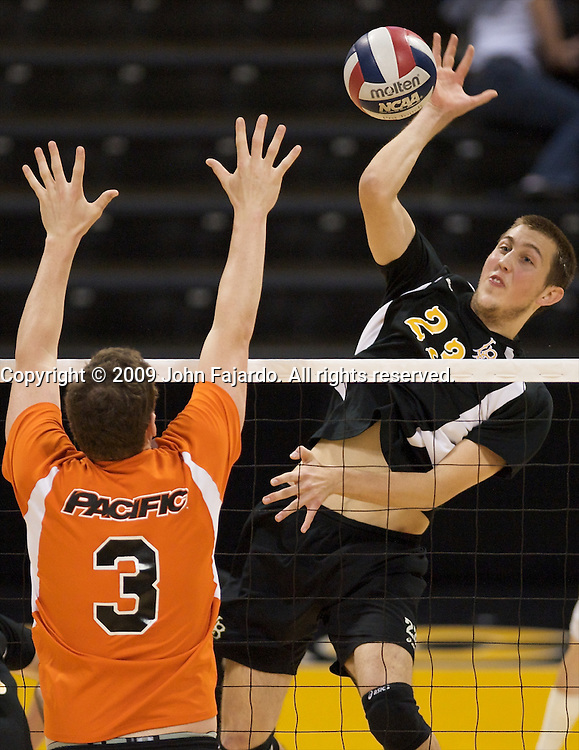 Srdjan Nadazdin(23) hits for Long Beach State with Joe Forbes blocking in the Mountain Pacific Sports Federation match against Pacific at the Walter Pyramid, Long Beach CA, Saturday, April 4, 2009.  Long Beach State wins the match in five sets 29-31, 30-13, 25-30, 30-21, 15-8.