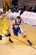 DESCRIZIONE : Ancona Lega A 2011-12 Fabi Shoes Montegranaro Bennet Cantu<br /> GIOCATORE : Carlos Gianella<br /> CATEGORIA : palleggio equilibrio<br /> SQUADRA : Bennet Cantu<br /> EVENTO : Campionato Lega A 2011-2012<br /> GARA : Fabi Shoes Montegranaro Bennet Cantu<br /> DATA : 11/01/2012<br /> SPORT : Pallacanestro<br /> AUTORE : Agenzia Ciamillo-Castoria/C.De Massis<br /> Galleria : Lega Basket A 2011-2012<br /> Fotonotizia : Ancona Lega A 2011-12 Fabi Shoes Montegranaro Bennet Cantu<br /> Predefinita :
