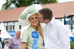 Repro Free: 08/08/2013 Ann Marie Blenner-Hassett from Co. Dublin was named the Blossom Hill Ladies' Day 'Best Dressed Lady'. Annemarie who just became a mum 8 weeks ago is pictured being congradulated by husband Jonathan as she won an incredible trip for two to leading fashion capital New York City, Woth €8000 including €1000 spending money. Pic Andres Poveda
