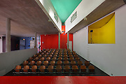 Theatre of the Maison du Bresil or Brazil House, designed by Le Corbusier (Charles-Edouard Jeanneret, 1887-1965), and Lucio Costa, 1902-1998, and inaugurated in 1954, with areas of bold painted colour, in the Cite Internationale Universitaire de Paris, in the 14th arrondissement of Paris, France. The building is listed as a historic monument and was renovated 1999-2000 by Bernard Bauchet and Hubert Rio. The CIUP or Cite U was founded in 1925 after the First World War by Andre Honnorat and Emile Deutsch de la Meurthe to create a place of cooperation and peace amongst students and researchers from around the world. It consists of 5,800 rooms in 40 residences, accepting another 12,000 student residents each year. Picture by Manuel Cohen. L'autorisation de reproduire cette oeuvre doit etre demandee aupres de l'ADAGP/Permission to reproduce this work of art must be obtained from DACS.