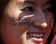 A participant, her face painted with Special Olympics logo, cheers as torch bearers carrying the torch arrive in downtown Los Angeles, where a cauldron will be lit two weeks ahead of the Special Olympics World Games' opening ceremony, on Tuesday, July 10, 2015. The Special Olympics Flame of Hope, which has been carried in a torch relay across the United States by thousands of runners on three routes, arrived in downtown Los Angeles,  The Special Olympics Flame of Hope officially arrived in Los Angeles after having traveled 46 days and over 20,500 miles as part of the first-ever Special Olympics Unified Relay Across America. The Unified Relay began its journey as three simultaneous routes in Augusta, Maine, Washington, D.C. and Miami, Florida on 26 May and has traveled west, visiting all 50 states, to deliver the Flame of Hope to Los Angeles in anticipation of the 2015 Special Olympics World Games starting on 25 July.(Photo by Ringo Chiu/PHOTOFORMULA.com)