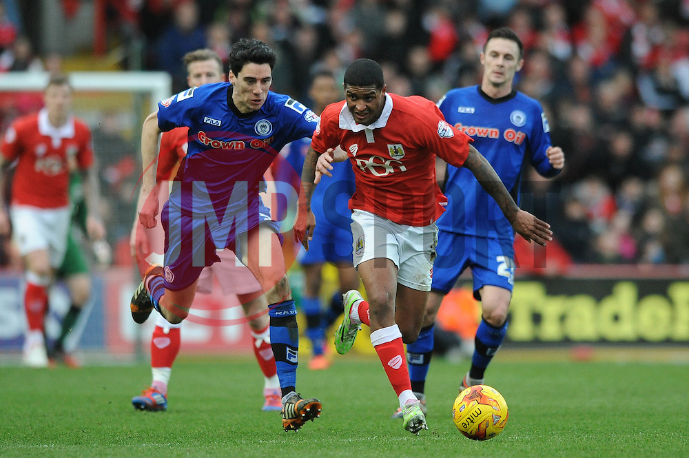 Bristol City's Mark Little is chased down by Rochdale's Peter Vincenti - Photo mandatory by-line: Dougie Allward/JMP - Mobile: 07966 386802 - 28/02/2015 - SPORT - football - Bristol - Ashton Gate - Bristol City v Rochdale AFC - Sky Bet League One