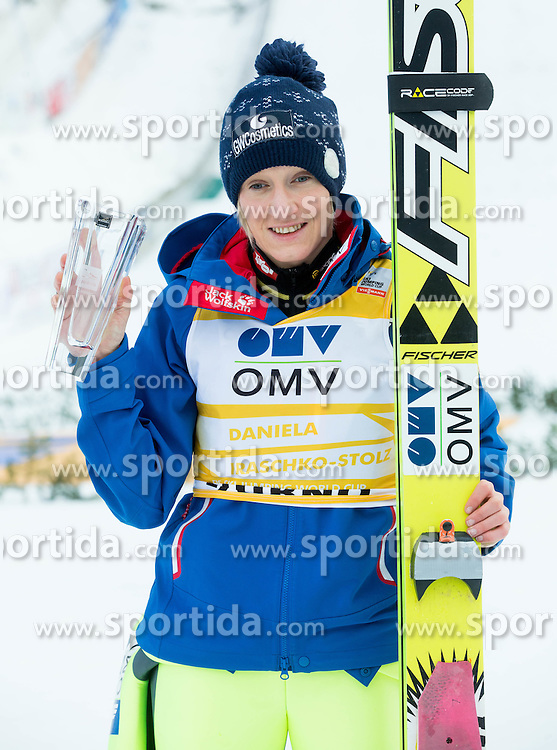 Second placed Daniela Iraschko-Stolz (AUT) celebrates during Flower ceremony after the Final Round at Day 1 of World Cup Ski Jumping Ladies Ljubno 2015, on February 14, 2015 in Ljubno, Slovenia. Photo by Vid Ponikvar / Sportida