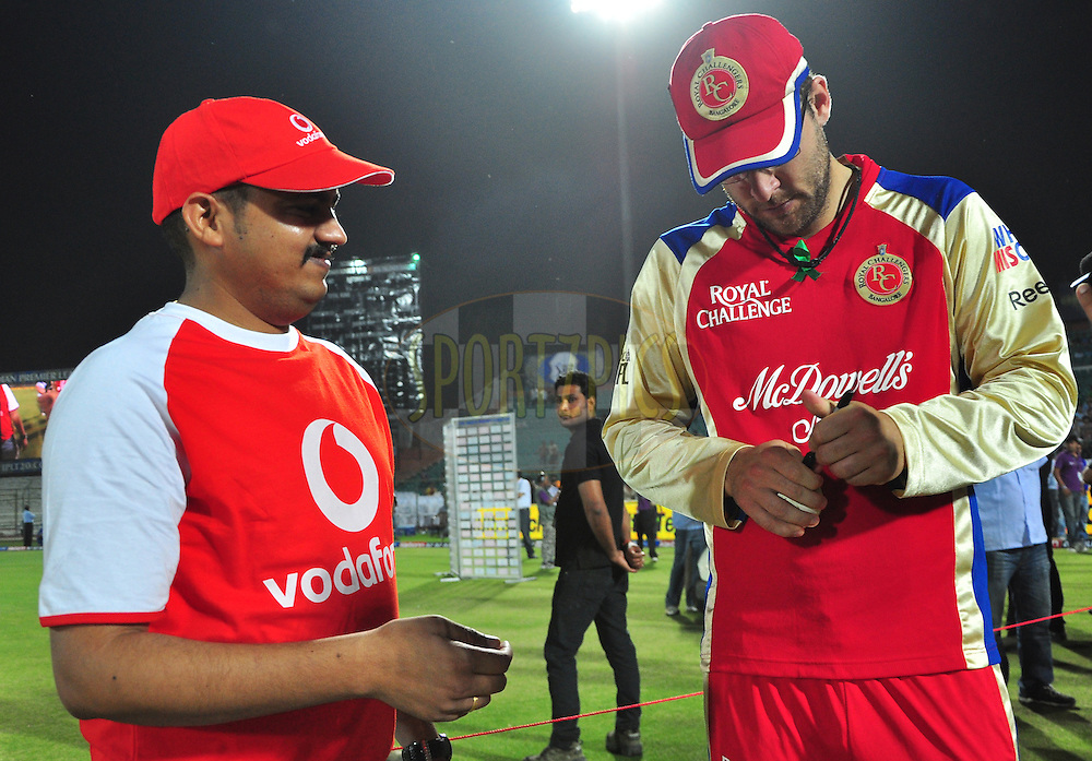 Danial Vettori of RCB signs the ball for the vodafone star of the match during match 30 of the the Indian Premier League ( IPL) 2012  between The Rajasthan Royals and the Royal Challengers Bangalore held at the Sawai Mansingh Stadium in Jaipur on the 23rd April 2012..Photo by Arjun Panwar/IPL/SPORTZPICS